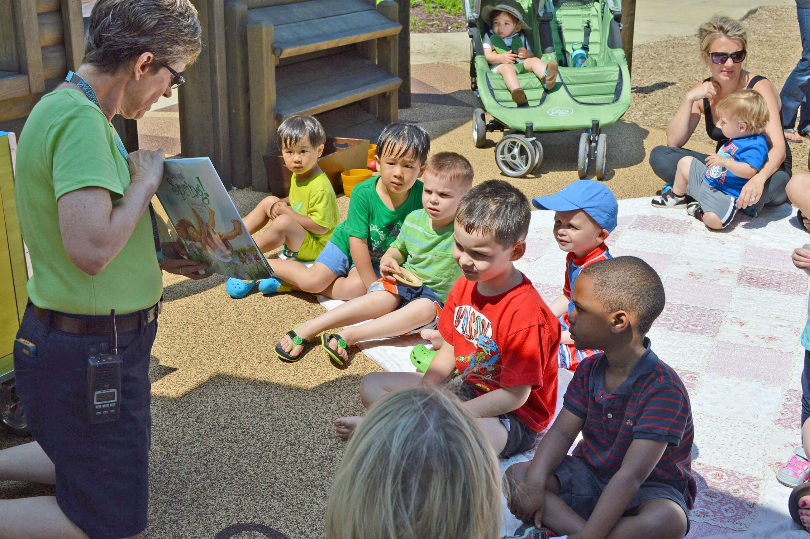 Children being told a story during the Playscape Readers at Naper Settlement