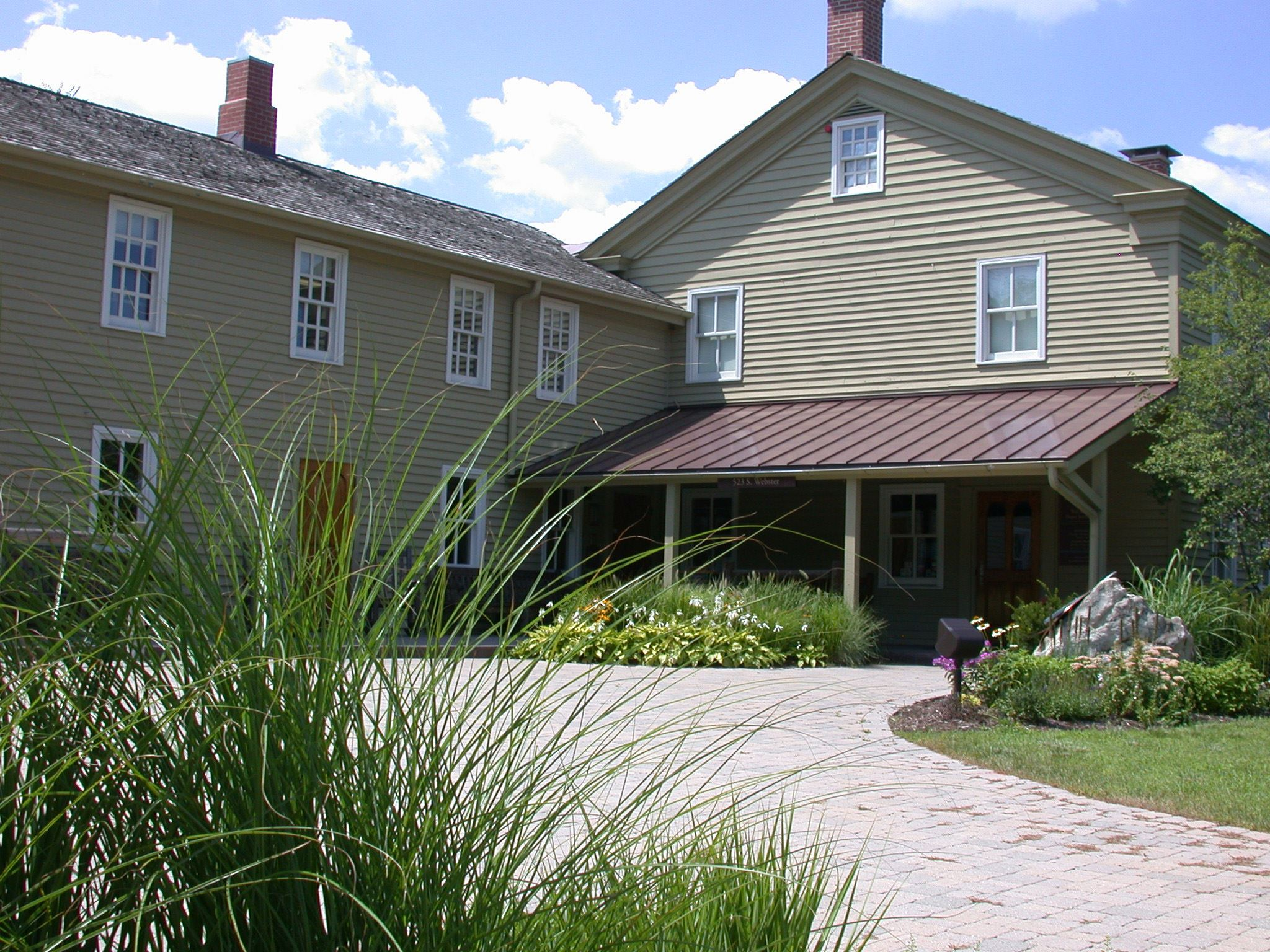 exterior view of Pre-Emption House with grasses in foreground
