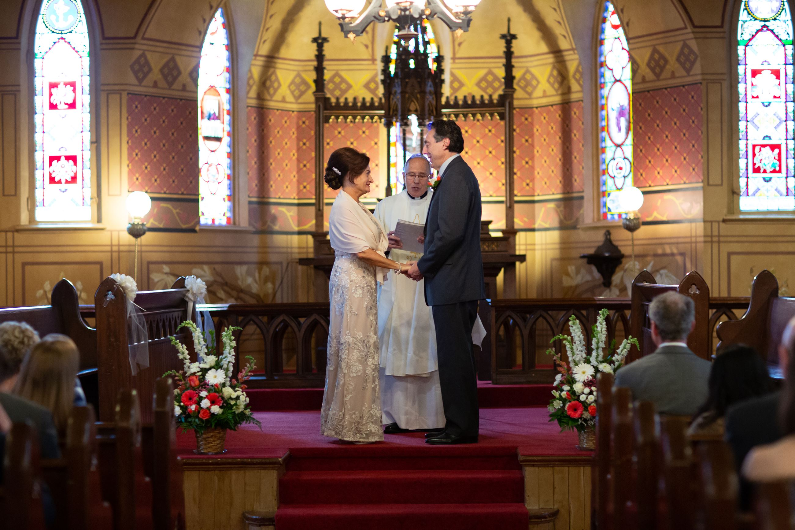 Couple being wed at alter at Century Memorial Chapel at Naper Settlement in Naperville, IL.