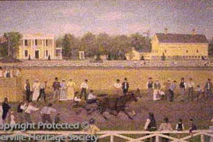 Horses racing on the race track