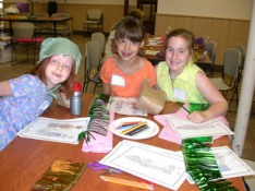 Girl scouts making crafts