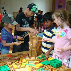 children playing with Lincoln Logs in History Connection